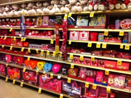 Chocolates and teddy bears line the shelves for Valentine's Day
