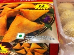 Green dot marking vegetarian option on Indian food packaging