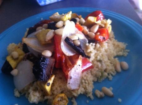 Portobello, peppers, onions, and veggies over couscous