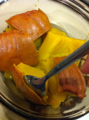 Remove the pumpkin skin with a spoon